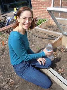 Kristin hand watering the garden