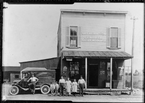Sher family in front of M. Sher & Sons General Merchandise, Columbia Pike and Walter Reed Drive, circa 1922. Charlie Sher can be seen in front of the family's Model T Ford Utility Truck.
