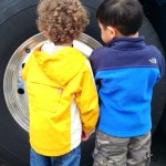 two boys with big tire