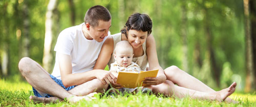 Family reading with preschool baby