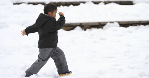 preschooler running in snow