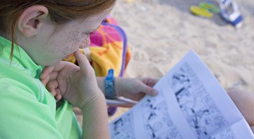 girl reading comics